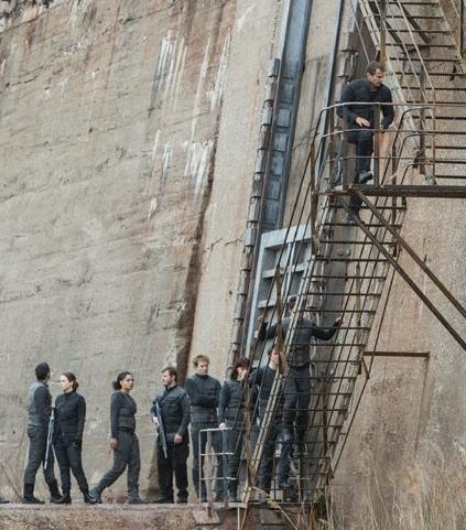 Initiates climb wall